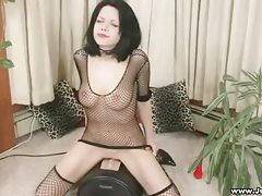 Fair skinned goddess with jet black hair riding sybian tubes