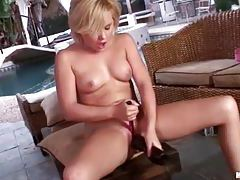 Lustful petite blonde getting in to her sex toys tubes