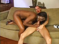 Curvaceous ebony babe fucks her submissive boy with strapon tubes