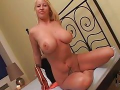Beautiful blonde milf lets her giant tits out tubes