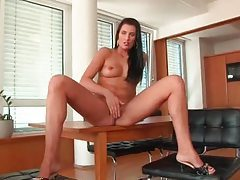She moves in erotic ways and touches her tits tubes