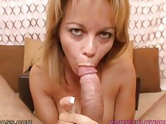 Blonde cougar with huge jugs giving a titjob tubes