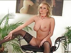 Blonde with huge boobs stripping in black lingerie tubes
