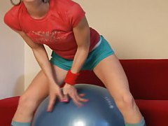 Skinny cute teen Candy plays on exercise ball tubes