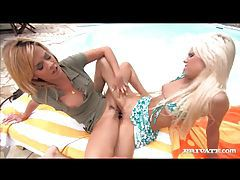 Horny blonde lesbian ladies using glass dildo at the pool tubes