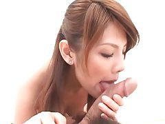 His cock head is thick and she sucks it tubes