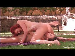 Sexy redhead works her brunette lover outdoors tubes