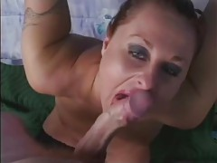 Horny milf stroking and sucking on a huge dong tubes
