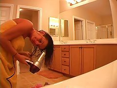 Hot chick does her hair after a shower tubes