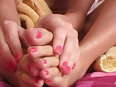 Close up rubbing of lotion into soft feet tubes