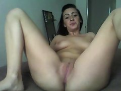 She models her pussy and plays with her clit tubes