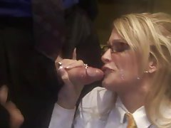 Corporate chick sucks off cocks in elevator tubes