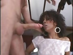 Pretty ebony babe with curly hair sucking on dick tubes