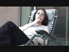 Lipstick girl smokes and talks naughty tube