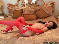 Shiny red heels and sexy red stockings tubes