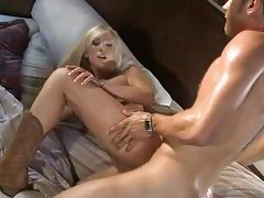 Chick in a cowgirl hat sucks and fucks tubes