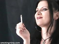 Dark makeup and lipstick on smoking goth girl tubes