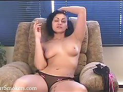 Short haired cougar has a smoke topless tubes