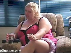 Fat blonde BBW smoking in her sexy lingerie tubes