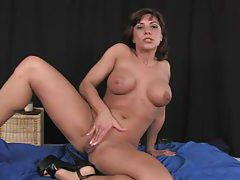 Very horny milf shoving a massive dildo in her wet cunt tubes
