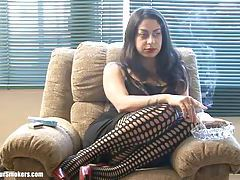 Sultry Latina milf showing off her legs whilst having a smoke tubes