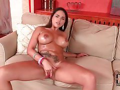 She rubs cream into her big sexy tits tubes