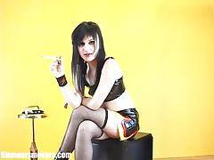 Fair skinned babe in fishnet stockings enjoying a smoke tubes
