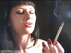 Mina lights up a long sexy cigarette tubes
