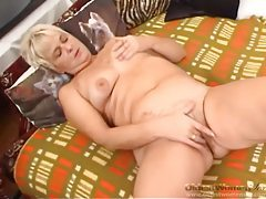 Curvy mature blonde sucks and fucks with a toy tubes