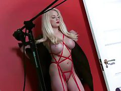 Busty bleach blonde bimbo poses in lipstick tubes