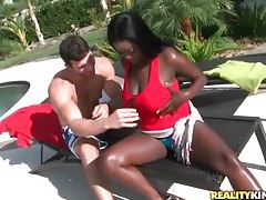 Smiling black girl knows her big tits are sexy tubes