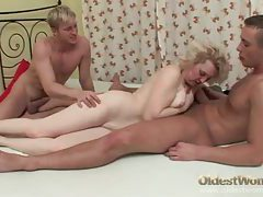 Old lady in lingerie stripped and fucked by two guys tubes