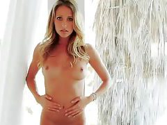 Gwen Barker has perky tits and shaved pussy tubes