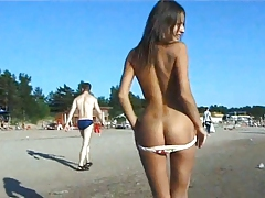 Naked teen riding a horse at the beach turns heads tube