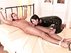 Mistress in black latex catsuit sucks dick tubes