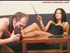 Sexy woman makes him worship her feet tubes