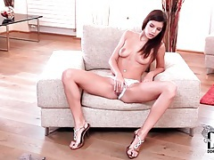 Girl in white lace panties plays with her pussy tubes