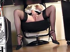 Leggy secretary fingering at the office in nylons tubes