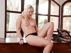 Hot blonde in a sexy dress strips tubes