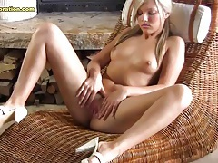 By the fire a slender blonde in pigtails poses tubes
