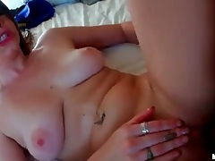 She has colorful tattoos as she fucks in POV video tubes