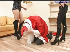 Chicks in boots abuse guy in Santa costume tubes