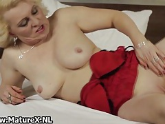 Horny blond mature housewife spreading her legs and stretches her wet pussy tubes