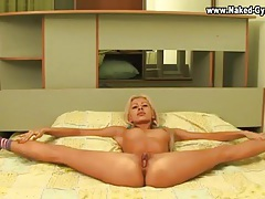 Tall flexible teenager in blonde pigtails tubes