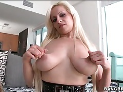 Curvy blonde in nerd glasses shows her tits tubes