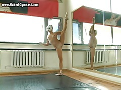 Ballet dancer warms up and strips naked tubes