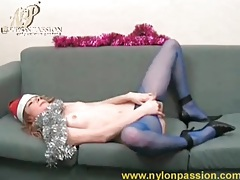 Christmas beauty in blue pantyhose rubs pussy tubes
