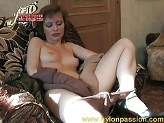 Slim girl with small tits plays in pantyhose tubes