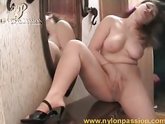 Masturbating girl with curves is sexy in pantyhose tubes