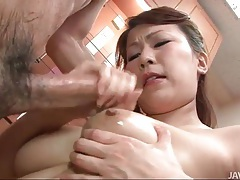 He fucks her tits and mouth in Japanese video tubes